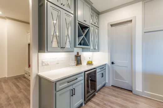 baby blue kitchen pantry with classic cabintry